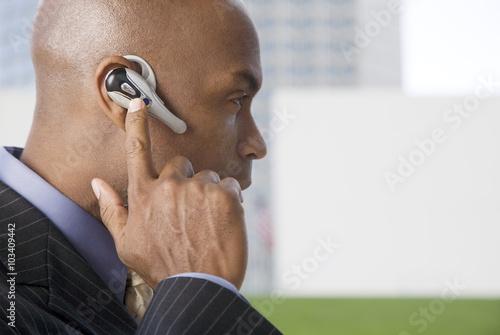 A businessman wearing a bluetooth headset Wallpaper Mural