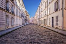 Picturesque Cobbled Street In Paris, France