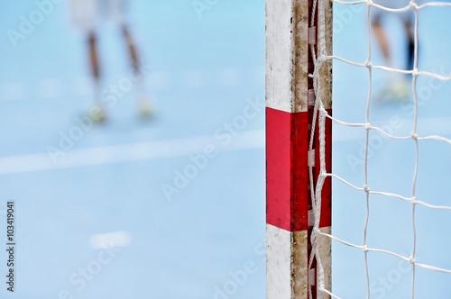 Fotografia, Obraz  Handball goalpost with players in background