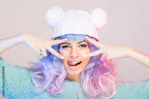Photo  Modern young woman with pastel pink and blue hair and beanie
