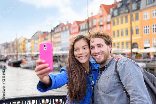 Copenhagen travel people taking friends selfie picture photos as souvenir with smartphone camera Poster