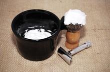 Shaving Brush With Foam, Razor And Mug On A Burlap Background, Retro Effect