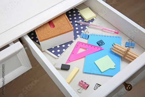 Stationery in open desk drawer closeup - Buy this stock