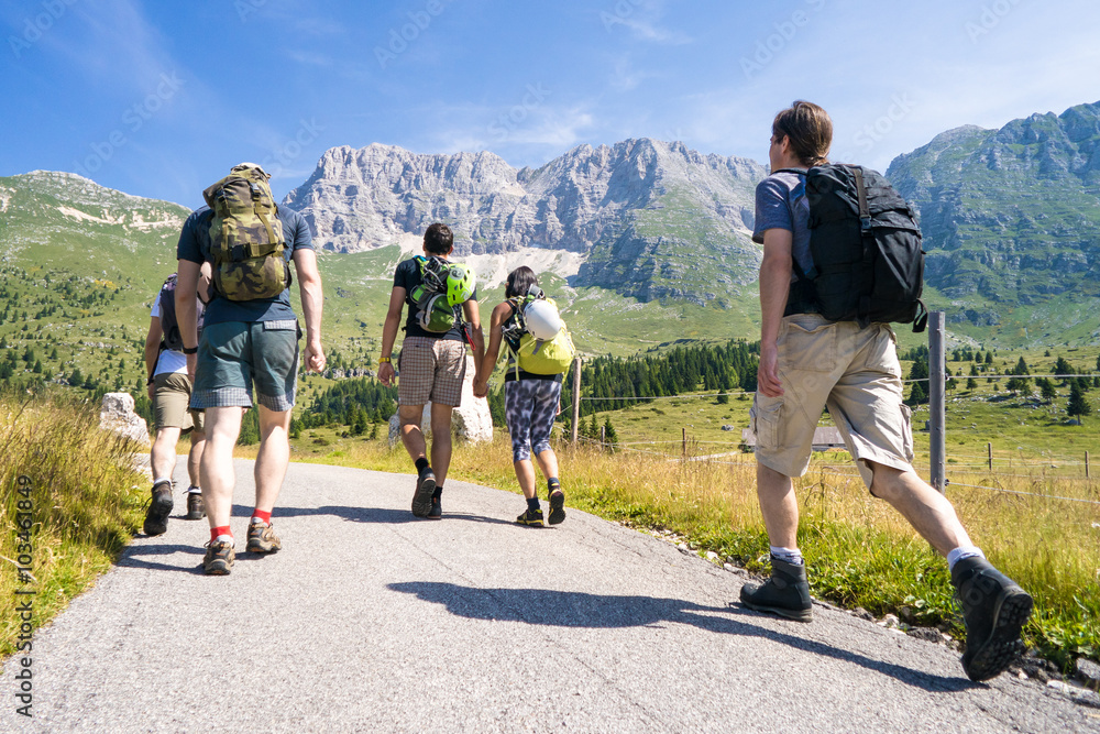 Fototapety, obrazy: group of climbers on the way, friends on a trip in the mountains, Alps in summer