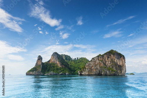 Thailand Chicken Head island cliff over ocean water during tourist boat trip in Railay Beach resort