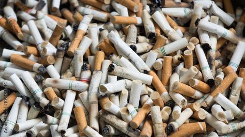 Fotografija  Cigarette butt in ashtray.
