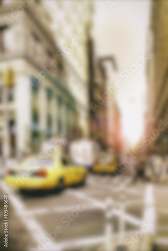 Foto op Plexiglas New York TAXI New York City street with yellow cab or taxi and sunlight Blur background