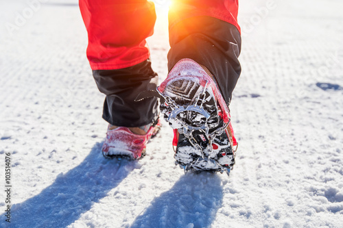 Foto auf AluDibond Bergsteigen View of walking on snow with Snow shoes and Shoe spikes in winte
