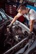 Man chcecking car parts