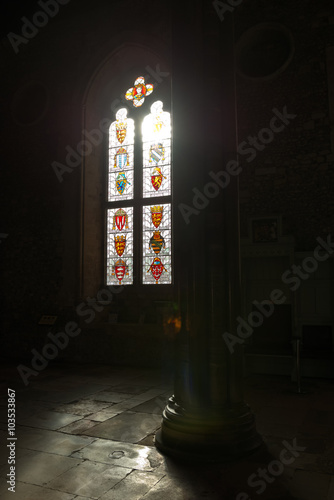 Photo  Stained glass windows in dark Winchester castle