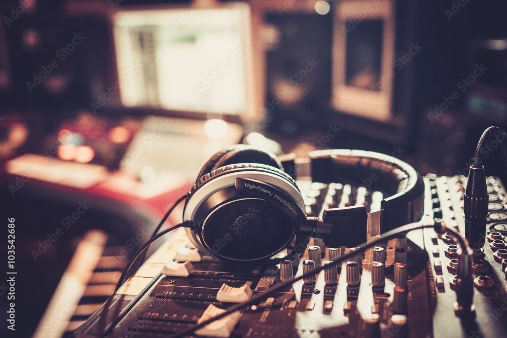 Fototapeta Close-up of boutique recording studio control desk.