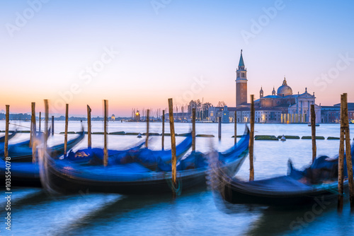 Spoed Foto op Canvas Venetian gondolas and San Giorgio di Maggiore church in background at morning before sunrise, long time exposure, Venice (Venezia), Italy, Europe