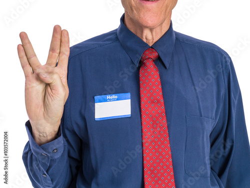 """Photo  Photo of senior man in a blue shirt and red tie wearing a """"Hello My Name Is"""" name tag and giving the hand signal to """"live long and prosper"""