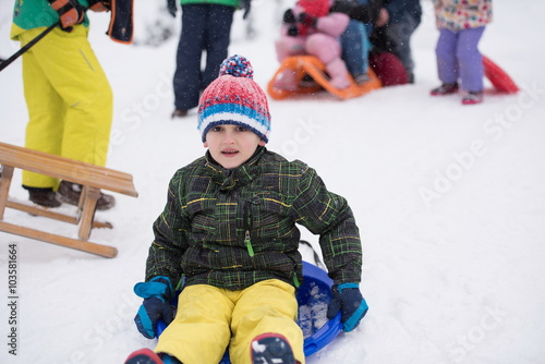 children group  having fun and play together in fresh snow