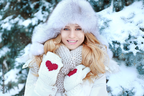 e96b986f2 Winter portrait of young beautiful blond woman in her warm clothing ...