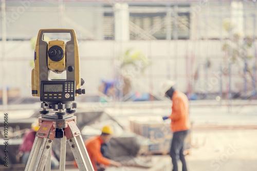 Fototapeta Surveyor equipment tacheometer or theodolite outdoors at constru