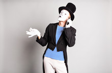 Man Mime  Talking On His Cell Phone. April Fool's Day Concept.