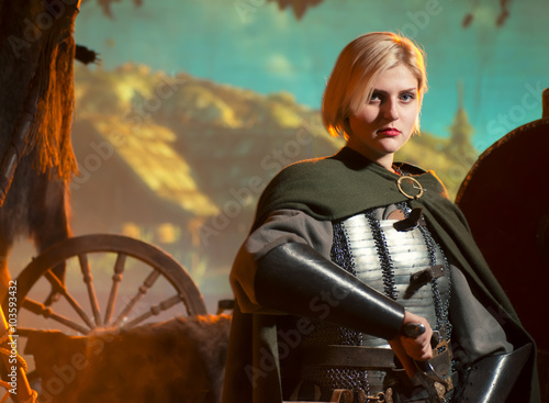 Princess Elf. Girl blonde in a metal medieval armor Poster