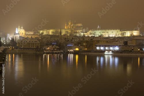 Papiers peints Paris Night romantic snowy Prague gothic Castle with Charles Bridge and St. Nicholas' Cathedral , Czech republic