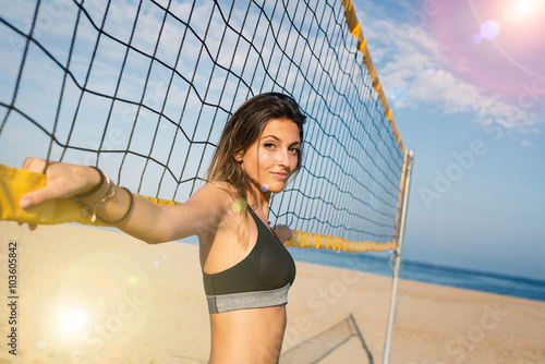 Beautiful beach volleyball female player portrait. Back light ef Poster