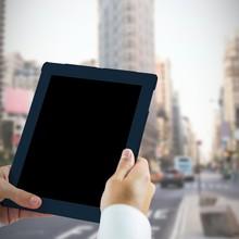 Man Using Tablet Pc Against New York Street