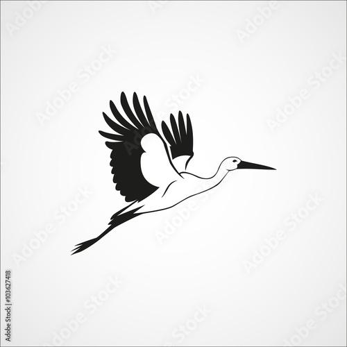 Fotografia flying stork simple silhouette on a white background vector illu
