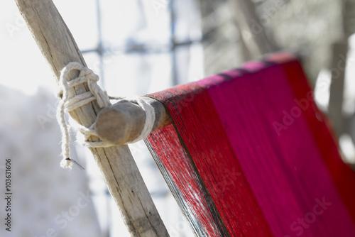 Fotografie, Obraz  Vintage manual weaving loom with unfinished textile work