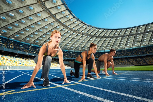 fototapeta na drzwi i meble Young sporty people at large modern stadium
