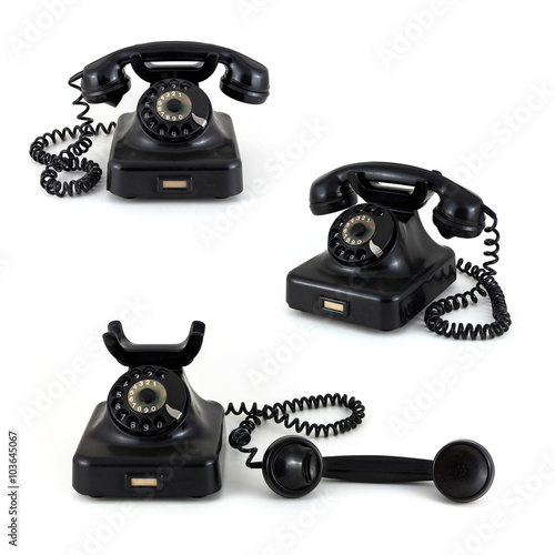 Three old telephones on a white background - Buy this stock
