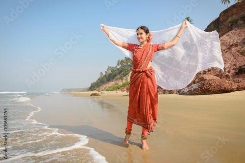 obraz lub plakat Beautiful indian woman in red saree whith white scarf