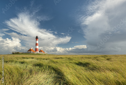 Montage in der Fensternische Leuchtturm scenic landscape with famous Westerhever lighthouse at North Sea coast, Schleswig-Holstein, Germany, Europe