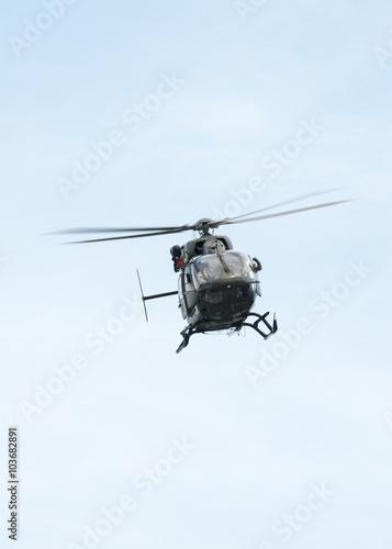 Staande foto UH-72A Lakota flies over head with doors open