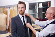 Young modern businessman visiting tailor