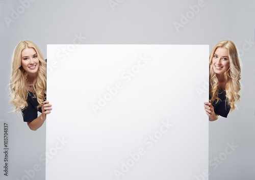Twins on the both sides of empty placard Canvas Print