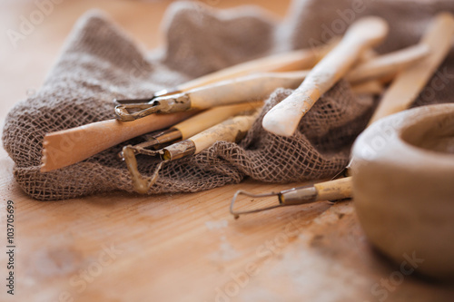 Set of dirty craft sculpting tools in pottery workshop Fototapeta