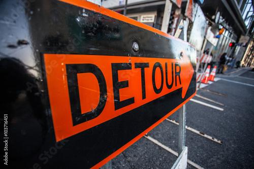 Fotografie, Obraz  Big orange sign Detour in the middle of the street