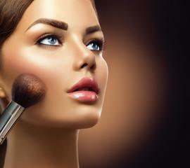 Makeup. Beauty model girl applying make-up  closeup