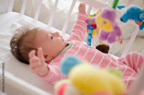 Fototapeta baby in a cot obraz na płótnie