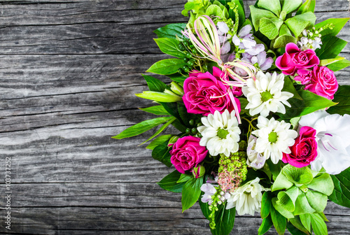 obraz lub plakat wedding bouquet with roses and white gerberas on an old wooden t