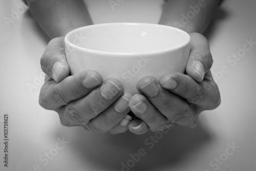 Fotografija Hunger begging with white bowl