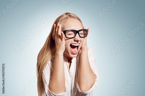 Fotografering  Closeup portrait stressed, frustrated shocked business woman pulling hair out yelling screaming temper tantrum isolated wall background