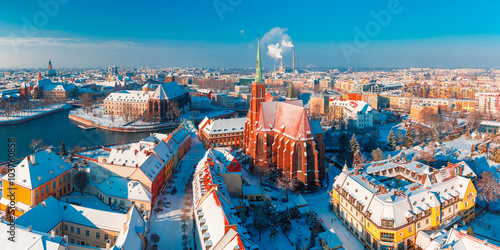 Aerial scenic panorama of Old Town and Ostrow Tumski with church of the Holy Cross and St. Bartholomew from Cathedral of St. John in the winter morning in Wroclaw, Poland