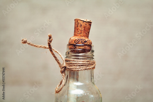 old glass bottle with a cork and rope Canvas Print