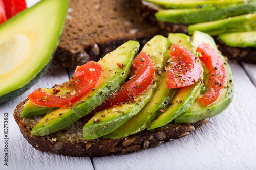Tasty avocado sandwich with tomato and seasoning for slimming.