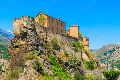 Fotografie, Obraz  Citadel built on top of a hill in Corte town, Corsica island, France