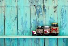 Jars Of Fruit Jelly On Rustic Teal Blue Wood Shelf