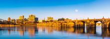 Harrisburg, Pennsylvania Skyline With The Historic Market Street Bridge Reflected On The Susquehanna River At Sunset