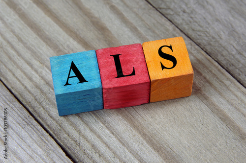 ALS (Amyotrophic Lateral Sclerosis) acronym on colorful wooden c Wallpaper Mural