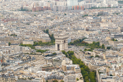 Valokuva  Color DSLR wide angle stock skyline of Paris, France, with the Arc de Triomphe at the center