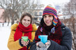 Young couple drinking tea in winter